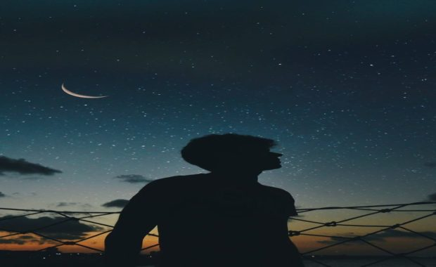 man in front of night sky